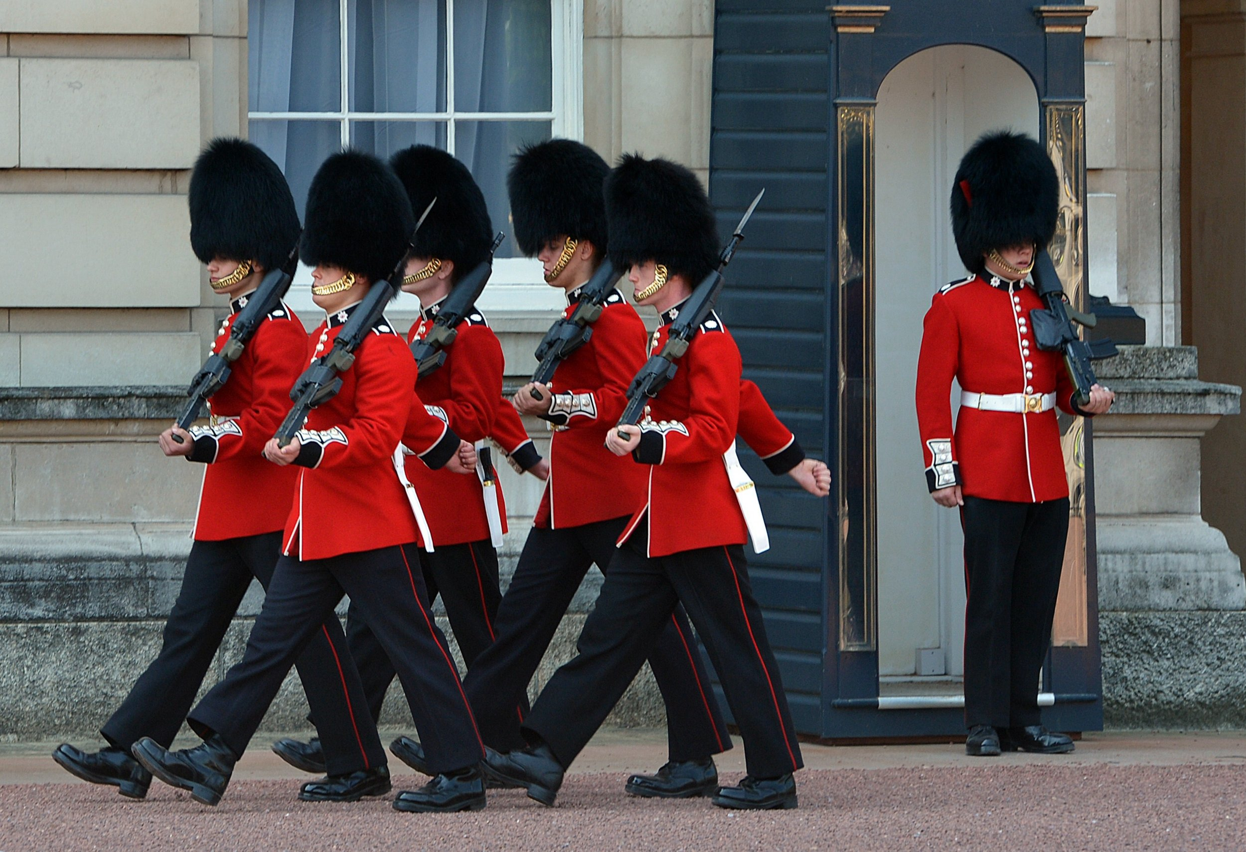 Members of the Queen's Guards march outside Buckingham Palace in central London on July 26, 2012. British Prime Minister David Cameron declared security his main concern on the eve of the London Olympics after the city's security preparations had been called into question in comments by US Republican presidential candidate Mitt Romney, who is in London to attend the opening ceremony. AFP PHOTO/Mark RALSTON (Photo credit should read MARK RALSTON/AFP/Getty Images)