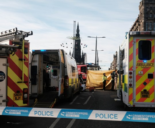 Rescuers lift taxi off woman crushed on Princes Street