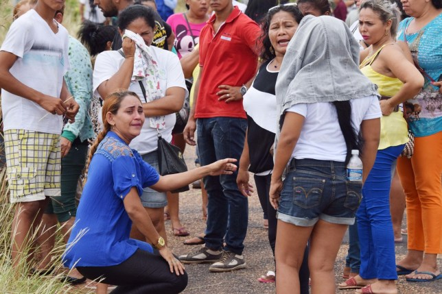 BRAZIL OUT - Relatives wait for information on the welfare of inmates, outside the Agricultural Penitentiary of Monte Cristo, after dozens of prisoners were killed, in Boa Vista, Roraima state, Brazil, Friday, Jan. 6, 2017. Scores of inmates were slain, some with their hearts and intestines ripped out, during a prison killing spree led by Brazil's largest gang, authorities said. (Rodrigo Sales/Futura Press via AP) - BRAZIL OUT - NAO PUBLICAR NO BRASIL
