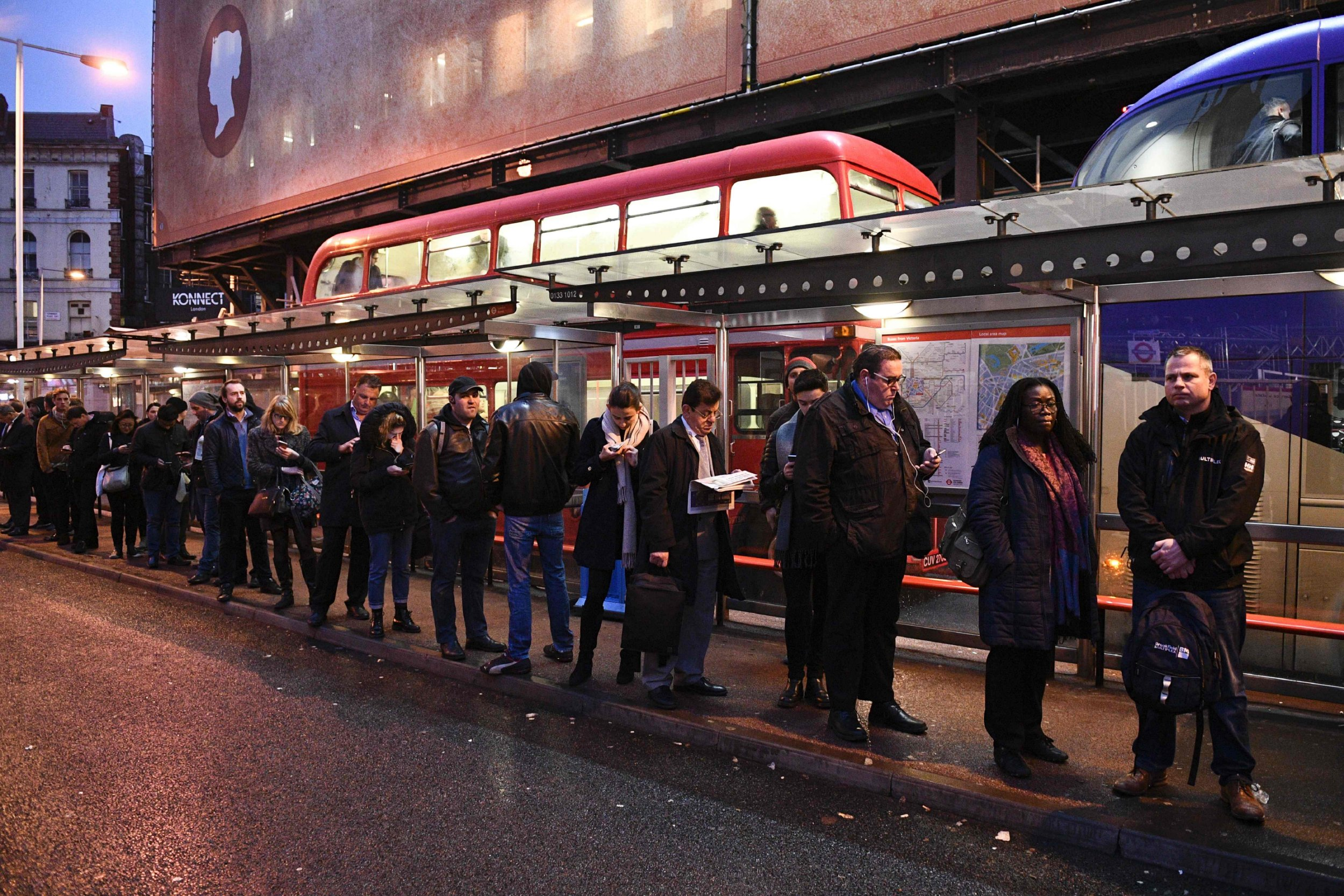 Commuters queue at Victoria bus station in central London on January 9, 2017 during a 24-hour tube strike. A strike on the London Underground caused major disruption on January 9, as almost all stations in the city centre shut and services were cancelled in a dispute over jobs and ticket office closures. Millions of passengers were forced to take overcrowded buses or overland trains, or work from home, after the 24-hour walk-out by the RMT union. / AFP PHOTO / Justin TALLISJUSTIN TALLIS/AFP/Getty Images