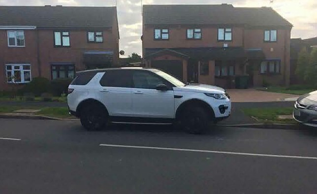 PIC FROM MERCURY PRESS (PICTURED: THE CONSITENT RUDE PARKER PARKING IN A LANDROVER DISCOVERY ACROSS A DRIVEWAY ON A RESIDENTIAL STREET IN DERBYSHIRE) Residents have been embroiled in a three-year parking war with a ëselfishí mum who allegedly dumps her giant 4x4 across driveways when dropping her child off at school ñ despite living just minutes around the corner. Former soldier Benjamin Broadhurst claims the female driver makes residentsí lives a misery in the quiet street in Derbyshire when parking her enormous white Land Rover Discovery twice a day. The 34-year-old has revealed a series of pictures that he says show how the driver routinely blocks driveways, causes traffic congestion and endangers lives by forcing pedestrians into the road. When confronted, Benjamin says the driver has been rude and claimed she can park where she likes, despite only living a few hundred yards away. Most shockingly, residents claim that she lives just a few minutesí walk away from the school but insists on driving her 4x4 to be as close to the school gates as possible. Police and council have told residents that there is nothing they can do and the school even provide parking at a nearby Asda and a pub. SEE MERCURY COPY