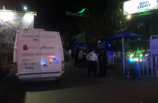 Mexican police agents, investigate at a nightclub near the beach in Playa del Carmen, Quintana Ro state, Mexico where 5 people were killed, three of them foreigners, during a music festival on January 16, 2017. A shooting erupted at an electronic music festival in the Mexican resort of Playa del Carmen early Monday, leaving at least five people dead and sparking a stampede, the mayor said. Fifteen people were injured, some in the stampede, after at least one shooter opened fire before dawn at the Blue Parrot nightclub during the BPM festival. / AFP PHOTO / ANGEL RUBIO YEPEZANGEL RUBIO YEPEZ/AFP/Getty Images