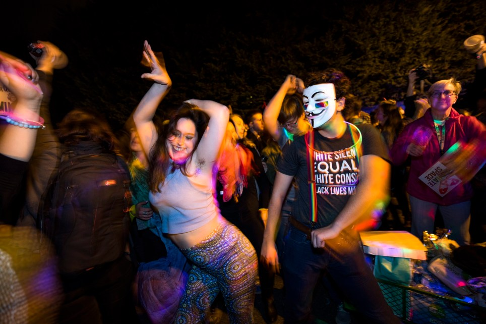 epa05729194 Supporters of LGTBQ rights hold a dance party in the middle of the street where Vice President-elect Mike Pence is temporarily renting a home before he moves to the Naval Observatory, in Washington, DC, USA, 18 January 2017. The dancers hoped to call attention to Pence's views on gay-right's issues, such as his equating homosexuality with 'societal collapse,' his opposition to the repeal of 'Don't Ask Don't Tell,' and his attempt in Indiana to ban same-sex marriages. EPA/JIM LO SCALZO