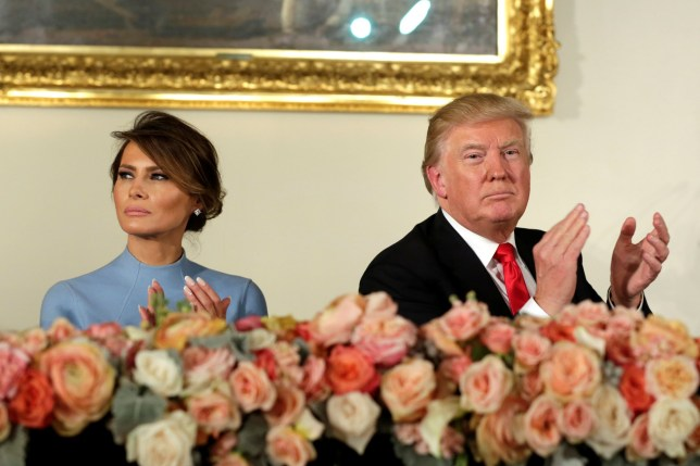 U.S. President Donald Trump and wife Melania attend the Inaugural luncheon at the National Statuary Hall after being sworn-in on Capitol Hill in Washington, U.S, January 20, 2017. REUTERS/Yuri Gripas