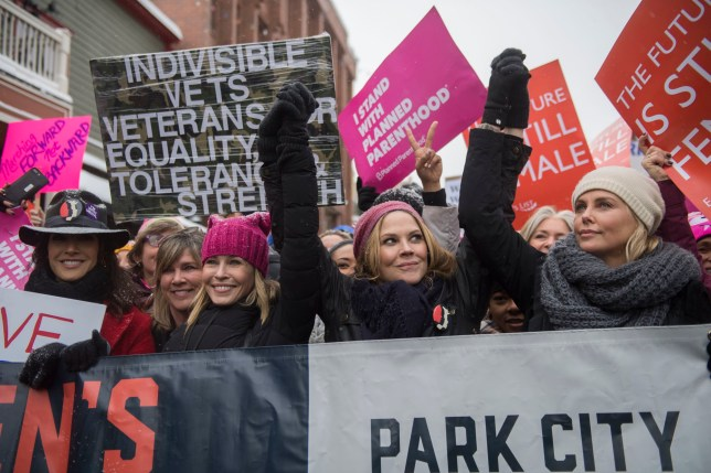 Chelsea Handler (L) and Charlize Theron (R) join the Women's March On Main at the 2017 Sundance Film Festival (Picture: Invision/AP)