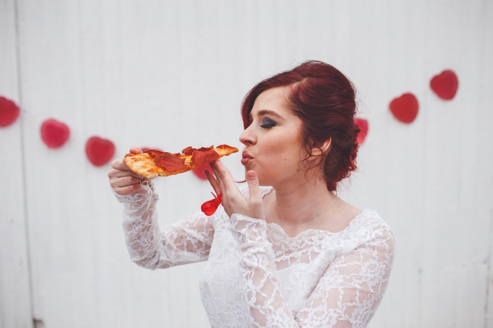 "A woman loves pizza so much ñ she decided to marry it. Christine Wagner was inspired to tie the knot with the dishy Italian after finding her grandmother's wedding dress. The 18-year-old, from Canal Winchester, Ohio, thought she looked good in the vintage gown so wanted to get hitched, but, in the absence of a current boyfriend, decided on the next best love of her life ñ pizza. The student and aspiring singer explains: ""It started as a joke when I first tried on the dress that I'd marry pizza, and Marcy Harris, my photographer, came up with the idea to take the idea further. It's a staple in my diet and very important to me. Marrying it just took it to the next level."" Marcy, a high school senior photographer, explains: ""Over the next couple days, Christine and I planned her dream wedding. She had so many amazing ideas, like the pizza should wear a bow tie, and the ring would obviously have to be a ring pop. We debated about having bacon roses, but because her mom was a bit worried about the dress getting dirty, we decided to stick with just a couple basic props. Christine was having her hair and makeup done by Beauty and the Blondes for homecoming, so we scheduled the shoot for that date. When I arrived, Christine was having her make-up finished. A large pepperoni pizza from Cristyís Pizza in Baltimore was cooling off in the kitchen. When she was all ready, we walked next door to a white barn on her family farm and thatís where the magic happened."" The romantic shoot sees Christine decked out in white, while and her groom sports tomato outerwear, pepperoni embellishments and a Pokemon bow tie. Unfortunately the wedding couldn't be completed as... the bride got peckish and ate her hubby-to-be. ""It was sad at first, but that feeling went away quickly. That said, it was really good,"" adds Christine. Where: Canal Winchester, Ohio, United States When: 15 Jan 2017 Credit: Marcy Harris/Cover Images **All usages and enquiries, please contact Glen Marks at glen.marks@cover-images.com - +44 (0)20 3397 3000**"