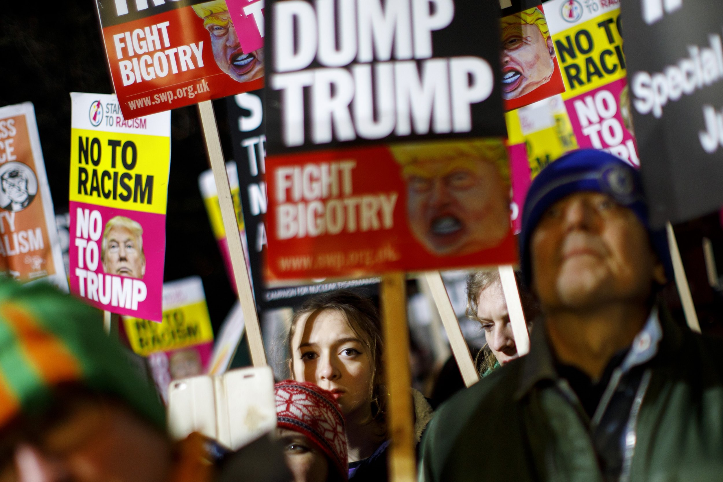 LONDON, UNITED KINGDOM - JANUARY 20: People protest against the inauguration of the 45th President of the United States, Donald Trump outside the London US Embassy in London, United Kingdom on January 20, 2017. (Photo by Tolga Akmen/Anadolu Agency/Getty Images)