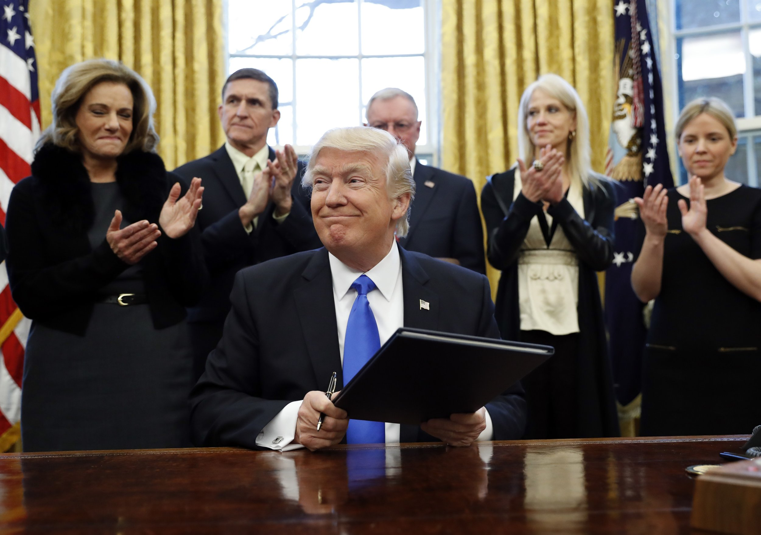 President Donald Trump smiles after signing an executive action in the Oval Office, Saturday, Jan. 28, 2017 in Washington. (AP Photo/Alex Brandon)