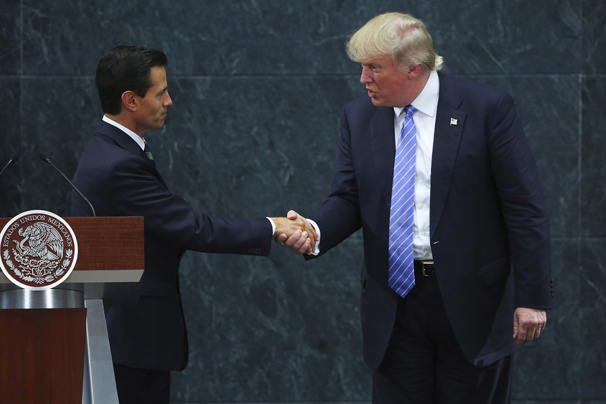 MEXICO CITY, MEXICO - AUGUST 31:  President of Mexico Enrique Pena Nieto greets US Republican presidential candidate Donald Trump during a meeting at Los Pinos on August 31, 2016 in Mexico City, Mexico. President of Mexico Enrique Pena Nieto invited both presidential candidates, Hillary Clinton and Donald Trump to talk about the bilateral relation between Mexico and the United States, being Trump the first one to accept the invitation. (Photo by Hector Vivas/LatinContent/Getty Images)