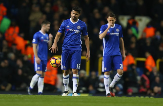 LONDON, ENGLAND - JANUARY 04: A dejected looking Diego Costa of Chelsea walks back with his team mates after Dele Alli of Tottenham Hotspur scores to make it 1-0 during the Premier League match between Tottenham Hotspur and Chelsea at White Hart Lane on January 4, 2017 in London, England. (Photo by Catherine Ivill - AMA/Getty Images)