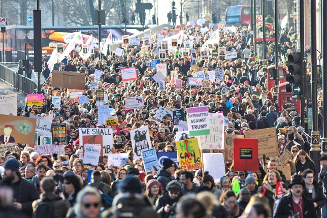 LONDON, ENGLAND - JANUARY 21: Protesters march from The US Embassy in Grosvenor Square towards Trafalgar Square during the Women's March on January 21, 2017 in London, England. The WomenÕs March originated in Washington DC but soon spread to be a global march calling on all concerned citizens to stand up for equality, diversity and inclusion and for womenÕs rights to be recognised around the world as human rights. Global marches are now being held, on the same day, across seven continents. (Photo by Jack Taylor/Getty Images)