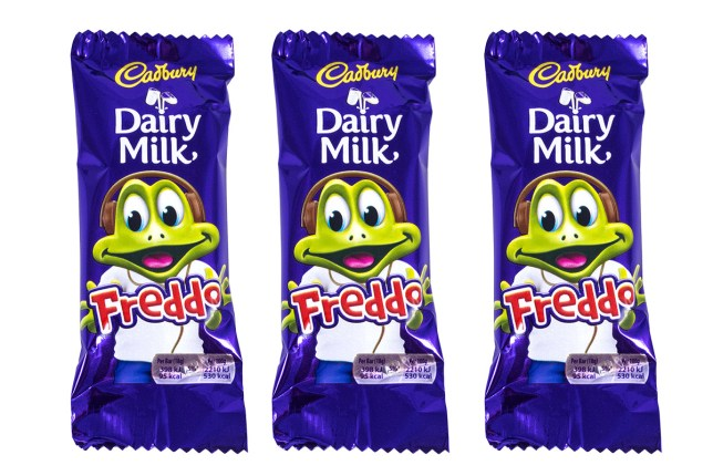LONDON, UK - JANUARY 4TH 2017: An unopened Freddo Dairy Milk chocolate bar manufactured by Cadbury, pictured over a plain white background on 4th January 2017.; Shutterstock ID 552195211