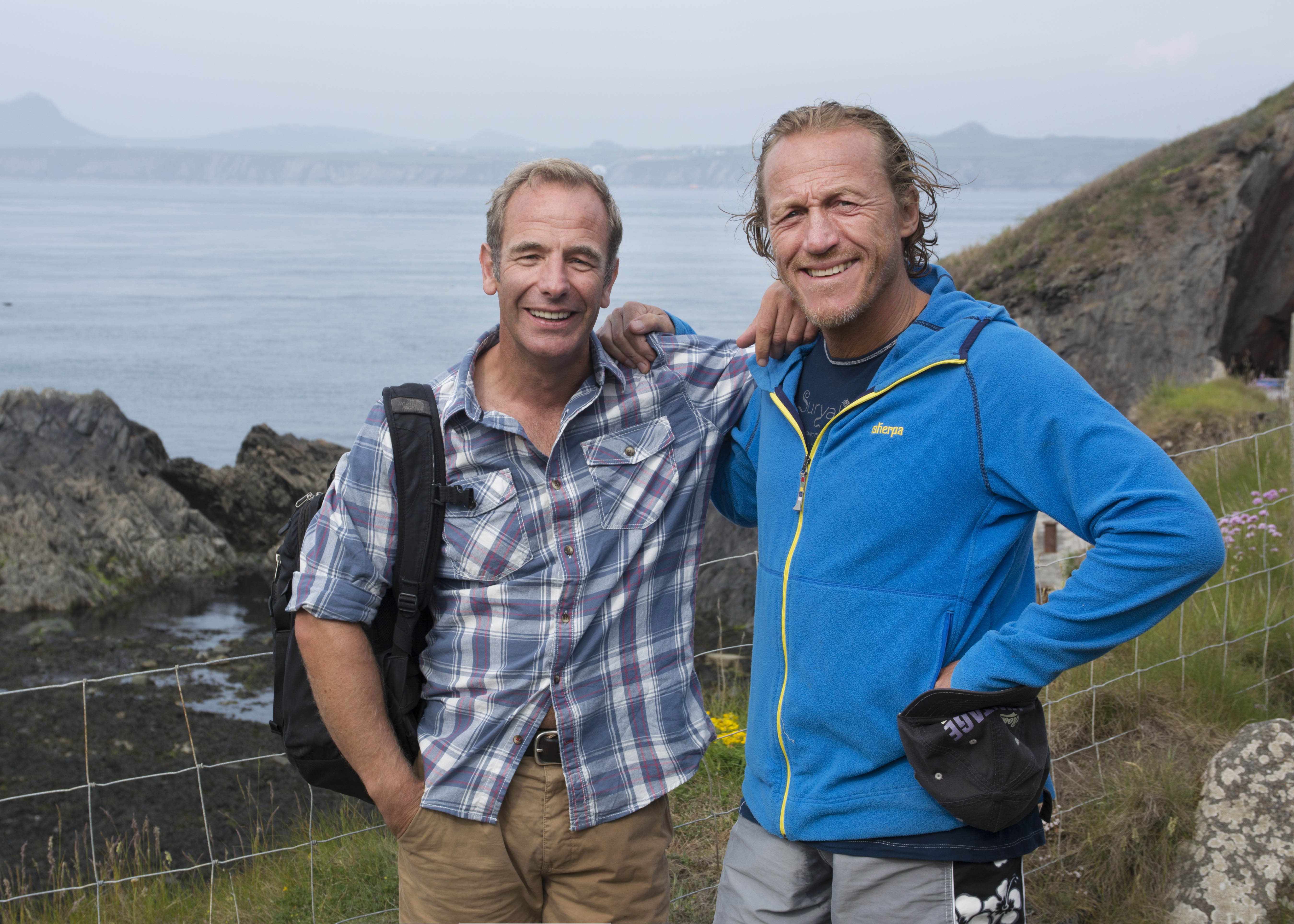 From Shiver Productions TALES FROM THE COAST WITH ROBSON GREEN Ep 2 Pembrokeshire Tuesday 7th February 2017 on ITV Pictured: Robson Green reunites with former Soldier Soldier co-star and singing partner Jerome Flynn - who is now living on the Pembrokeshire coast. In Episode Two, Robson visits one of the most exciting and dramatic stretches of coastline in Britain as he explores the hidden coves and remote islands of Pembrokeshire in South-West Wales. ThereÕs a reunion in store for Robson, as he meets up with his former Soldier Soldier co-star and singing partner Jerome Flynn - who is now living on the Pembrokeshire coast. They go sea kayaking around Ramsey Island and Robson attempts to navigate some of the most dangerous tidal rapids off British shores. On Skokholm Island, Robson spends twenty-four hours living and working with its only human inhabitants - wildlife wardens Giselle Eagle and Richard Brown, a couple who look after an incredible array of seabirds - including the largest concentration of Manx Shearwaters in the world. Robson also goes cliff jumping in a disused quarry known as The Blue Lagoon and meets a man who creates giant sand art at Mwnt Beach. © ITV Photographer: Alysoun Sharpe For further information please contact Peter Gray 0207 157 3046 peter.gray@itv.com This photograph is © ITV and can only be reproduced for editorial purposes directly in connection with the programme TALES FROM THE COAST WITH ROBSON GREEN or ITV. Once made available by the ITV Picture Desk, this photograph can be reproduced once only up until the Transmission date and no reproduction fee will be charged. Any subsequent usage may incur a fee. This photograph must not be syndicated to any other publication or website, or permanently archived, without the express written permission of ITV Picture Desk. Full Terms and conditions are available on the website www.itvpictures.com