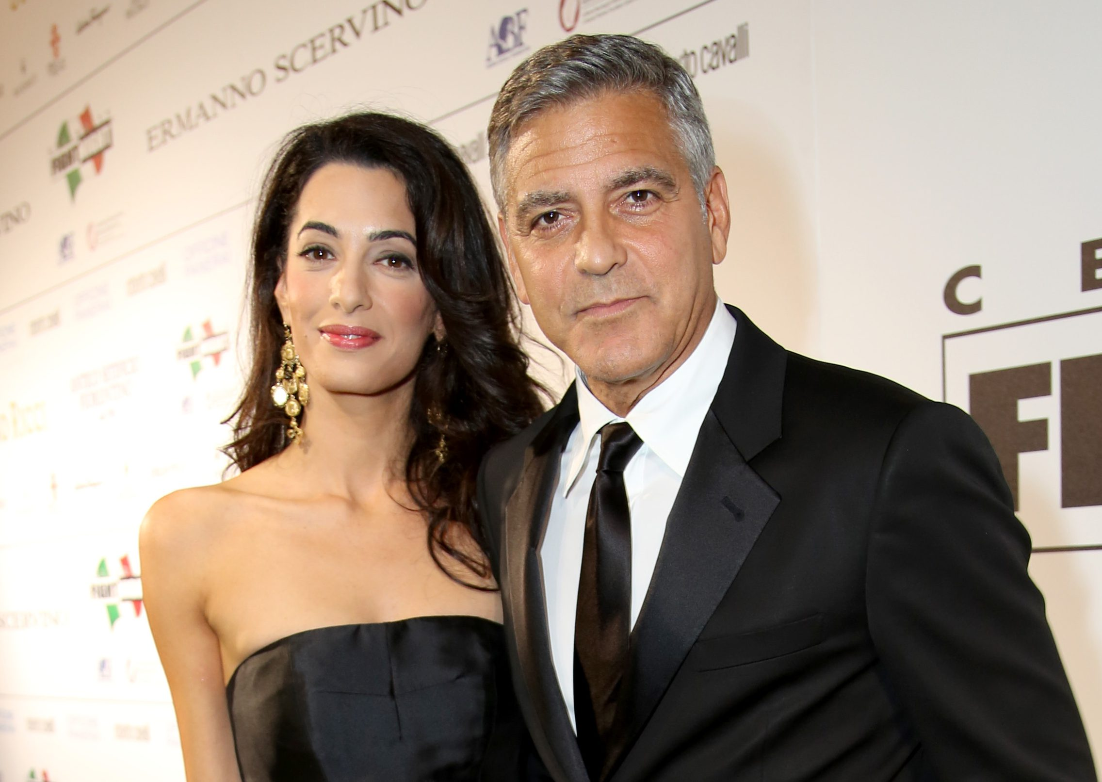 FLORENCE, ITALY - SEPTEMBER 07: George Clooney (R) and Amal Alamuddin attend the Celebrity Fight Night gala celebrating Celebrity Fight Night In Italy benefitting The Andrea Bocelli Foundation and The Muhammad Ali Parkinson Center on September 7, 2014 in Florence, Italy. (Photo by Rachel Murray/Getty Images for Celebrity Fight Night)