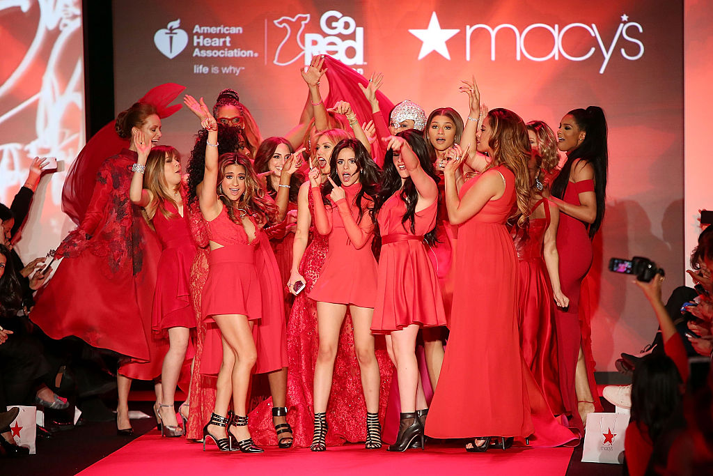 Why are American women wearing red dresses this month?