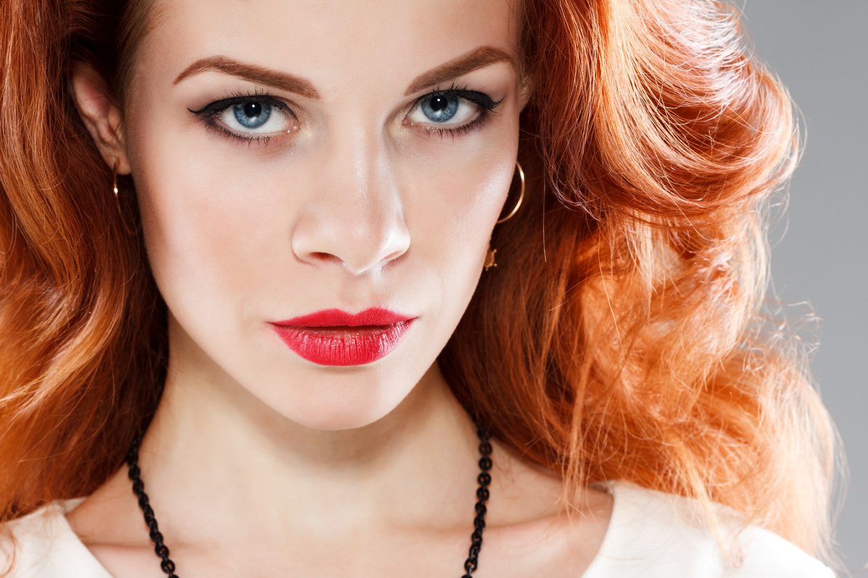 Beautiful sensual woman with long red hair
