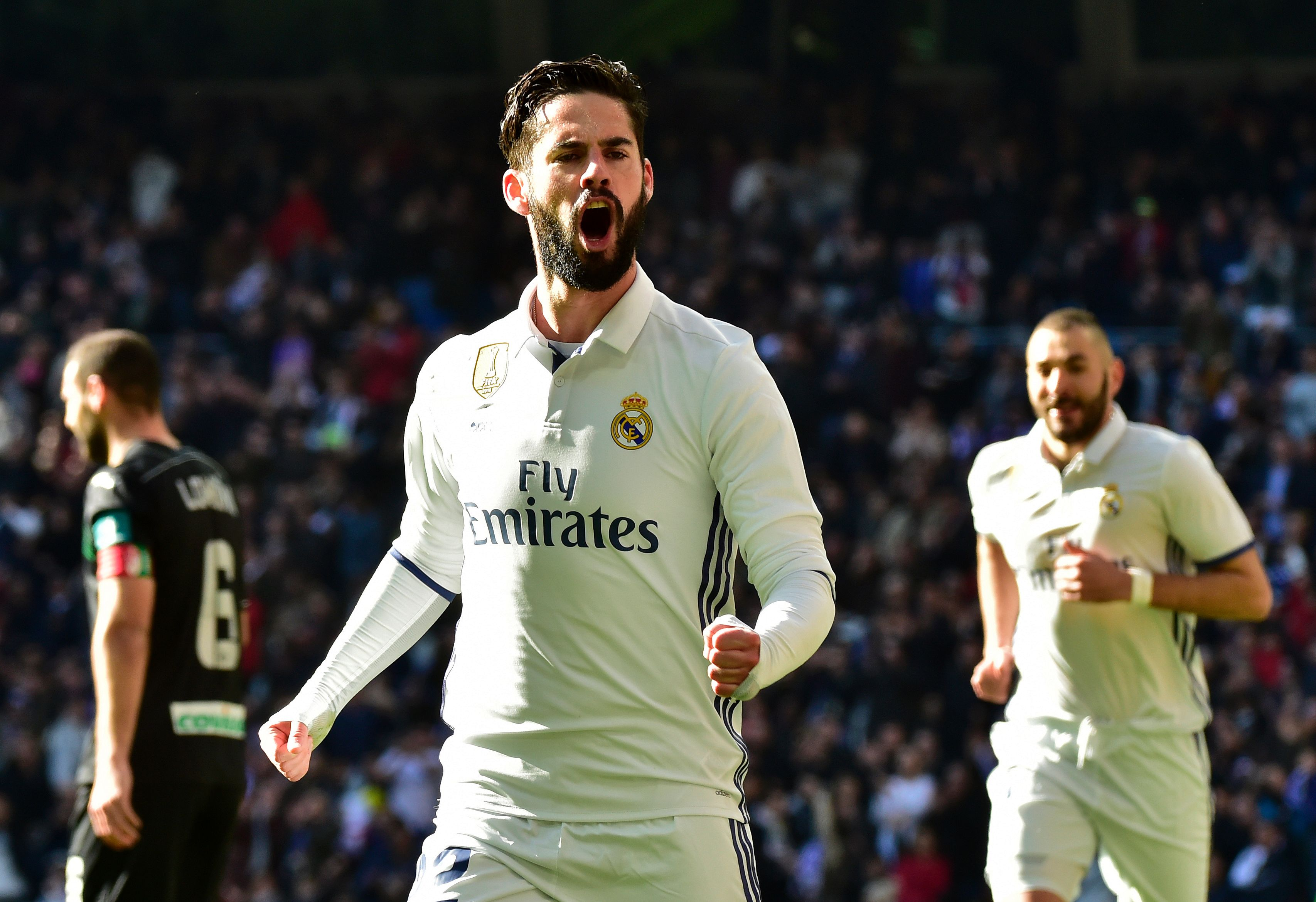 Real Madrid's midfielder Isco celebrates after scoring during the Spanish league football match Real Madrid CF vs Granada FC at the Santiago Bernabeu stadium in Madrid on January 7, 2017. / AFP / GERARD JULIEN (Photo credit should read GERARD JULIEN/AFP/Getty Images)