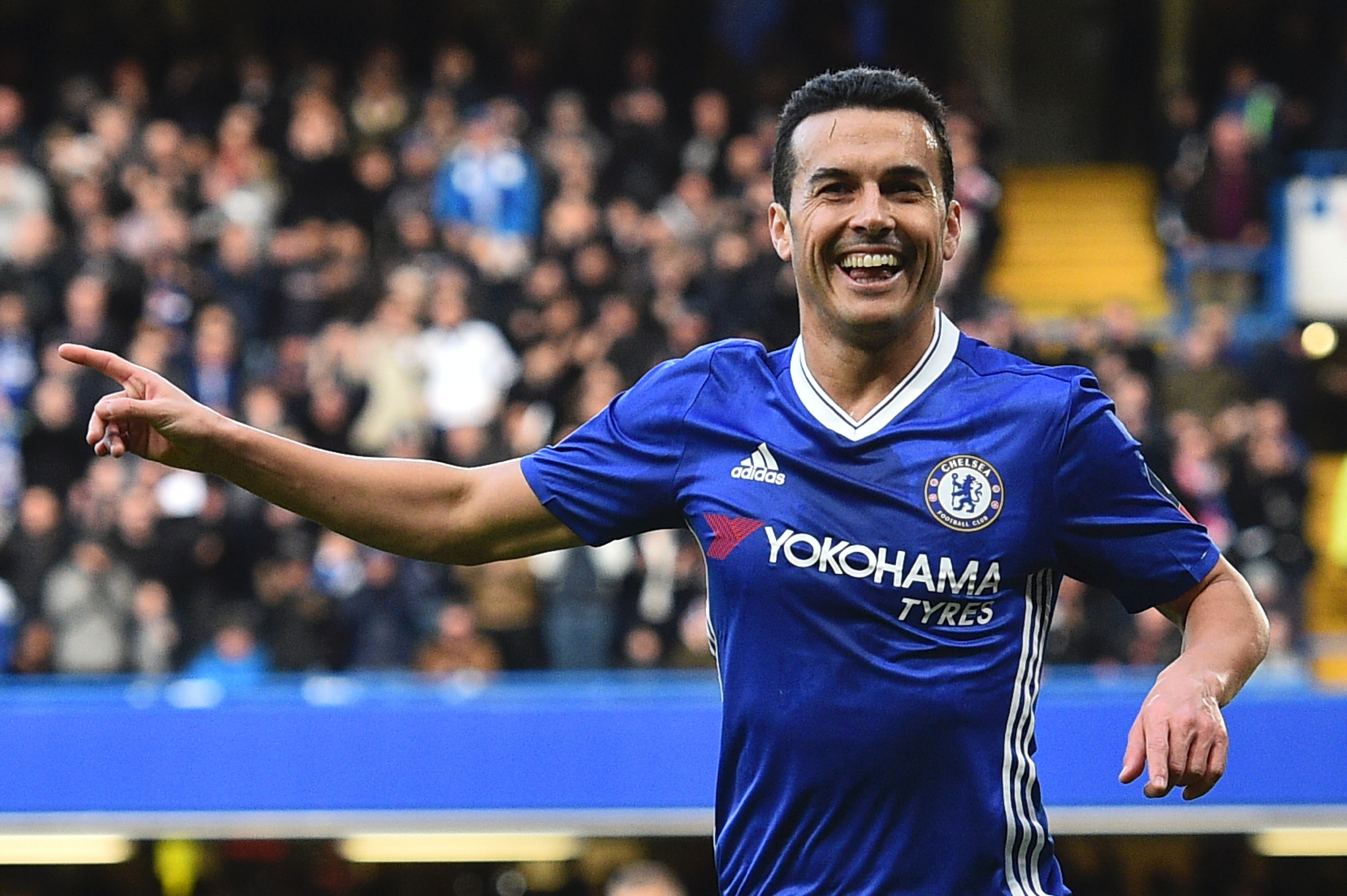 Chelsea's Spanish midfielder Pedro celebrates scoring their second goal during the English FA Cup fourth round football match between Chelsea and Brentford at Stamford Bridge in London on January 28, 2017. / AFP / Glyn KIRK / RESTRICTED TO EDITORIAL USE. No use with unauthorized audio, video, data, fixture lists, club/league logos or 'live' services. Online in-match use limited to 75 images, no video emulation. No use in betting, games or single club/league/player publications. / (Photo credit should read GLYN KIRK/AFP/Getty Images)