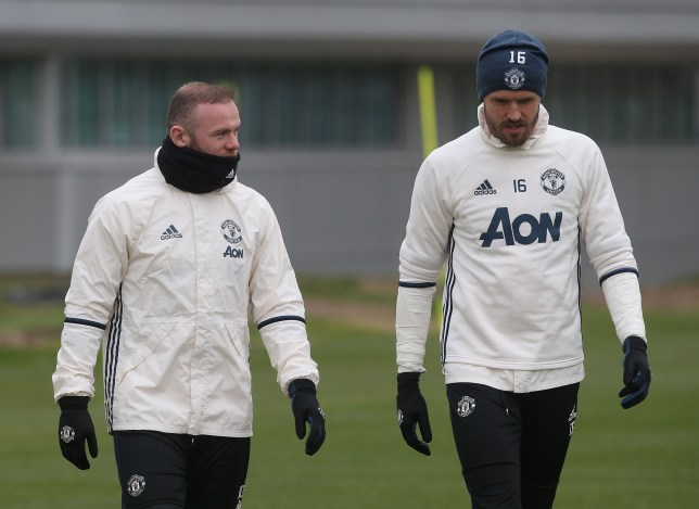MANCHESTER, ENGLAND - FEBRUARY 08: (EXCLUSIVE COVERAGE) Wayne Rooney and Michael Carrick of Manchester United in action during a first team training session at Aon Training Complex on February 8, 2017 in Manchester, England. (Photo by John Peters/Man Utd via Getty Images)