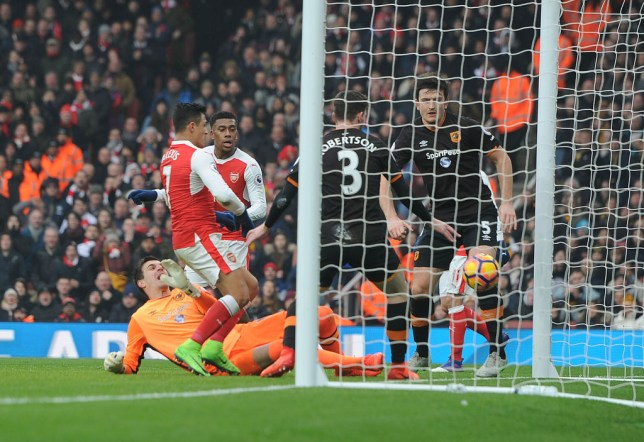 LONDON, ENGLAND - FEBRUARY 11: (L) Alexis Sanchez scores for Arsenal during the Premier League match between Arsenal and Hull City at Emirates Stadium on February 11, 2017 in London, England. (Photo by Stuart MacFarlane/Arsenal FC via Getty Images)