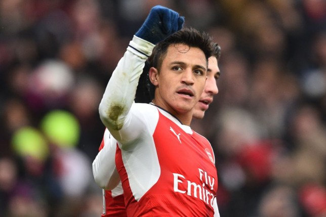 Arsenal's Chilean striker Alexis Sanchez (L) celebrates with Arsenal's Spanish defender Hector Bellerin after scoring the opening goal of the English Premier League football match between Arsenal and Hull City at the Emirates Stadium in London on February 11, 2017.  / AFP / Glyn KIRK / RESTRICTED TO EDITORIAL USE. No use with unauthorized audio, video, data, fixture lists, club/league logos or 'live' services. Online in-match use limited to 75 images, no video emulation. No use in betting, games or single club/league/player publications.  /         (Photo credit should read GLYN KIRK/AFP/Getty Images)