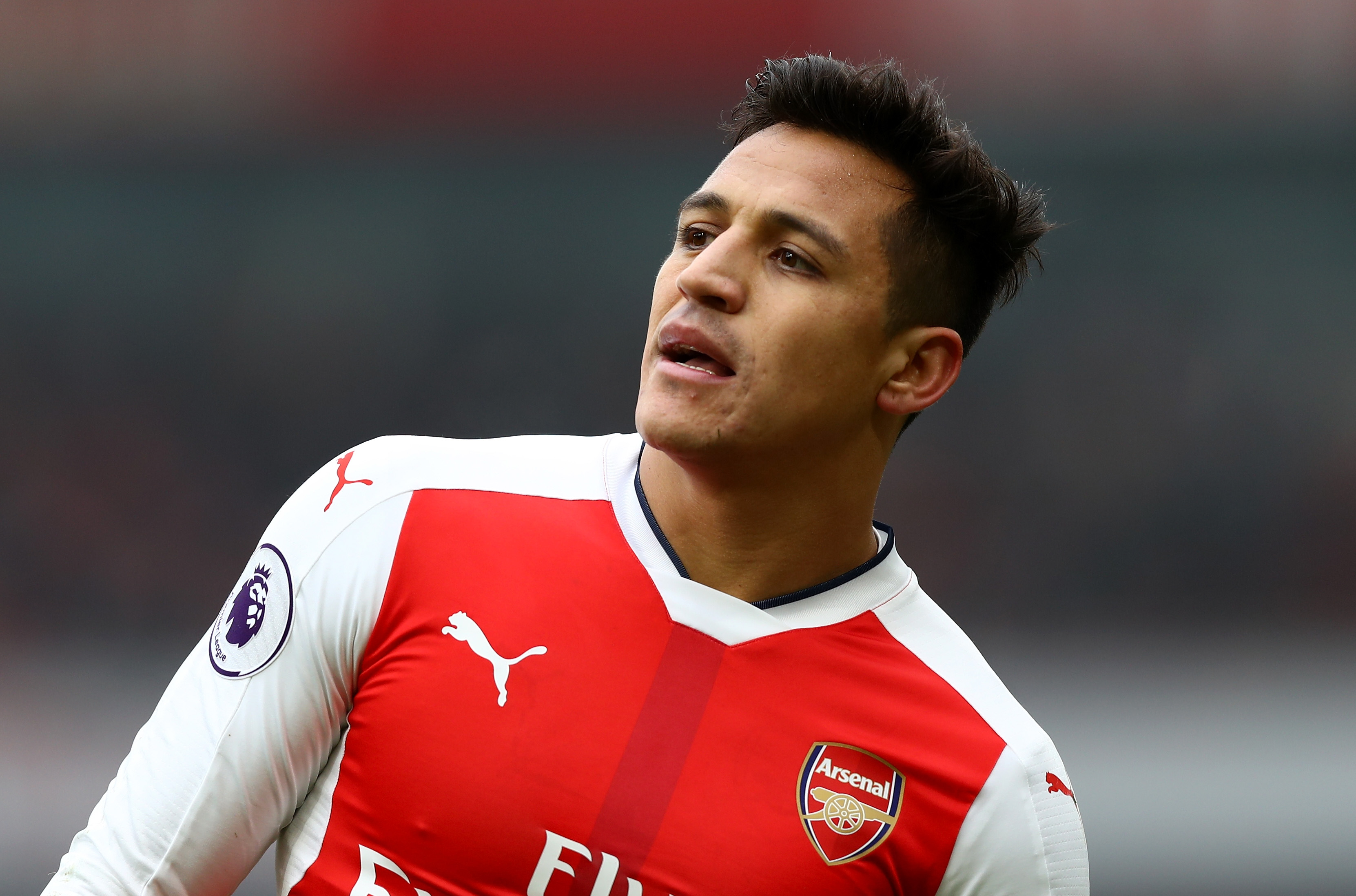 LONDON, ENGLAND - FEBRUARY 11: Alexis Sanchez of Arsenal looks on during the Premier League match between Arsenal and Hull City at Emirates Stadium on February 11, 2017 in London, England. (Photo by Clive Rose/Getty Images)