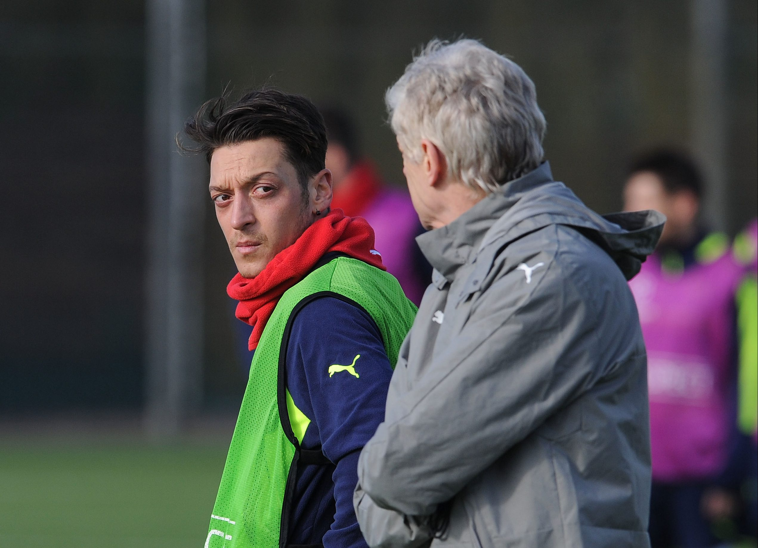 ST ALBANS, ENGLAND - FEBRUARY 14: Mesut Ozil and Arsene Wenger the Arsenal Manager during the Arsenal Training Session at London Colney on February 14, 2017 in St Albans, England.  (Photo by David Price/Arsenal FC via Getty Images)