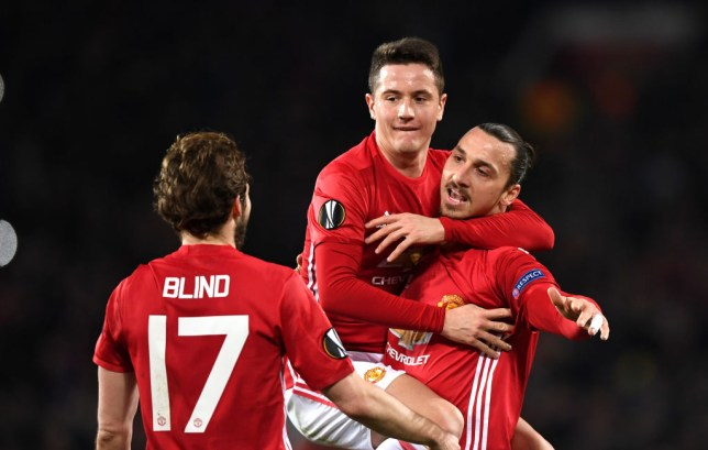 MANCHESTER, ENGLAND - FEBRUARY 16: Zlatan Ibrahimovic of Manchester United celebrates scoring his sides first goal with Ander Herrera during the UEFA Europa League Round of 32 first leg match between Manchester United and AS Saint-Etienne at Old Trafford on February 16, 2017 in Manchester, United Kingdom. (Photo by Shaun Botterill/Getty Images)