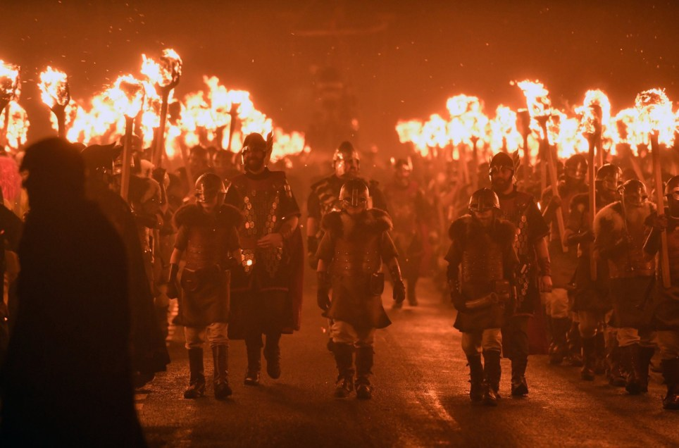 LERWICK, SCOTLAND - JANUARY 31: The Jarl squad begin to light torches at the culmination of Up Hell Aa on January 31, 2017 in Lerwick, Shetland. The traditional festival of fire, known as Up Helly Aa, takes place annually on the last Tuesday of January. The climax of the day came with participants wearing costumes as they hauled a Viking long boat through the streets of Lerwick to the edge of town where up to 1000 paraders set the vessel ablaze by throwing torches into the galley. (Photo by Jeff J Mitchell/Getty Images)