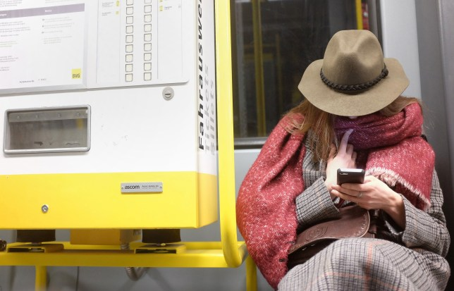 BERLIN, GERMANY - MARCH 09: A woman uses a mobile phone on the BVG M10 tram line on March 9, 2016 in Berlin, Germany. UK Prime Minister David Cameron has warned that his country's leaving the European Union, a process that would be known as Brexit, would lead to substantial economic issues for British consumers, including higher cell phone roaming rates. (Photo by Adam Berry/Getty Images)