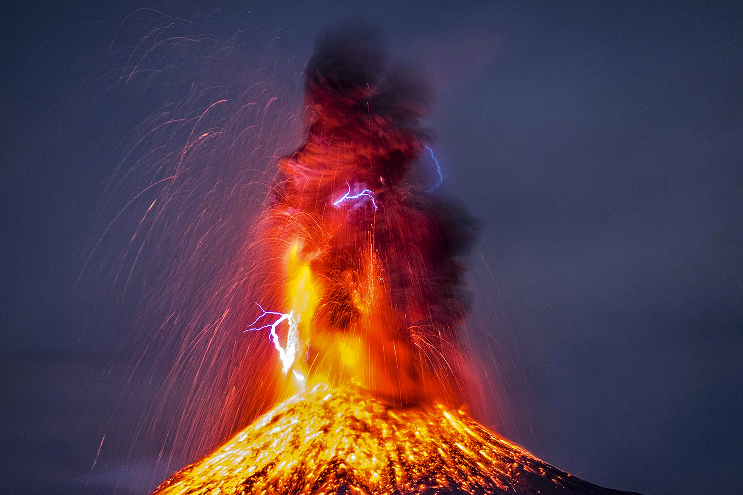 PIC BY HERNANDO RIVERA/MERCURY PRESS (PICTURED: THE INCREDIBLE LIGHTNING STRIKING THE ERUPTING LAVA AS IT SPEWS OUT OF THE VOLCAN DE COLIMA IN CENTRAL MEXICO. PIC DATE: 26.01.17) A graphic designer camped out in freezing cold conditions to capture a spectacular shot of an erupting volcano - only for a LIGHTNING BOLT to strike the lava spurt. Hernando Rivera struck gold with the dazzling star-spangled snaps as he sat opposite the famous Volc·n de Colima in central Mexico. The photographer took up the perfect vantage point 12km from the centuries-old volcano, which is currently active and surrounded by an 8km exclusion zone. His stunning series of pictures, taken last Thursday, show white-hot lava spouting from the crater 12,500ft above sea level, with the lightning bolt emerging from clouds of black smoke. SEE MERCURY COPY