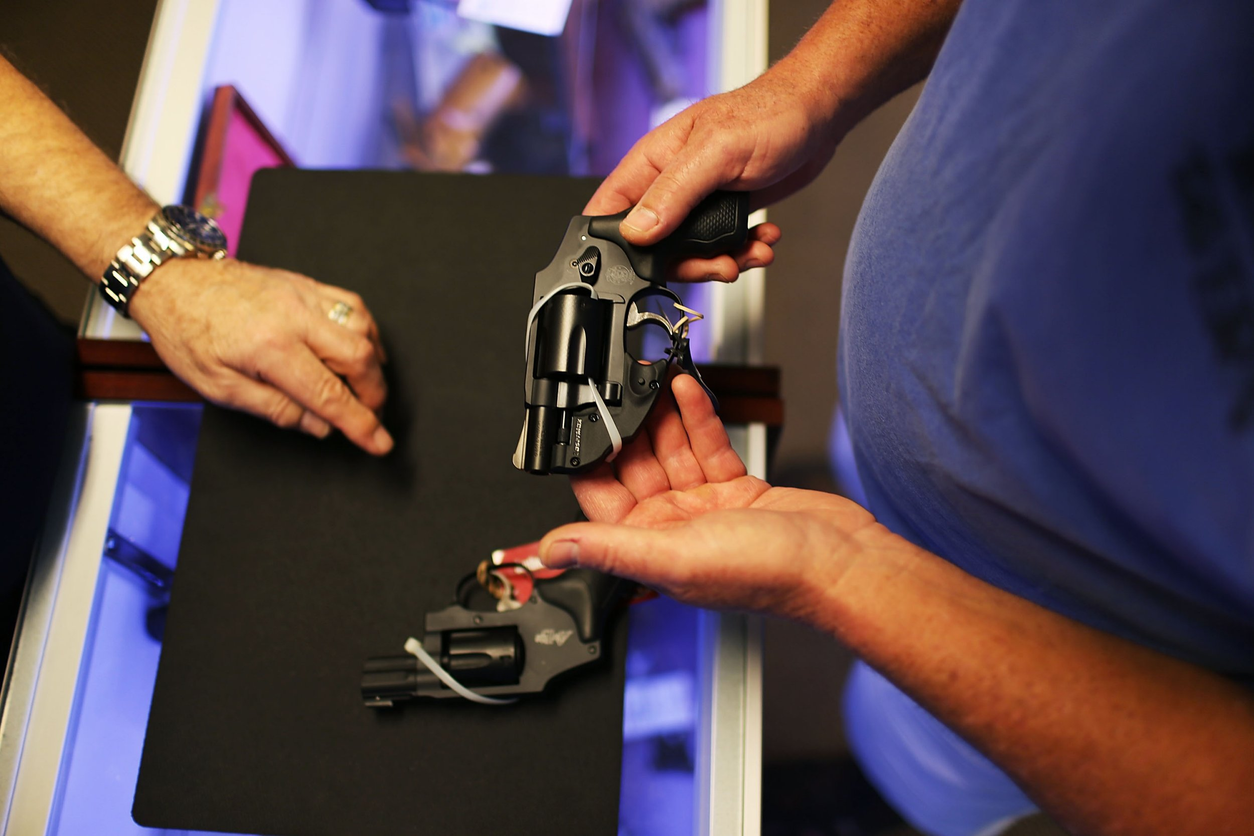 Thousands of Americans with mental illness could buy guns after Trump strikes down Obama's rule against it (Getty) DELRAY BEACH, FL - JANUARY 05: A customer shops for a handgun at the K&W Gunworks store on the day that U.S. President Barack Obama in Washington, DC announced his executive action on guns on January 5, 2016 in Delray Beach, Florida. President Obama announced several measures that he says are intended to advance his gun safety agenda. (Photo by Joe Raedle/Getty Images)