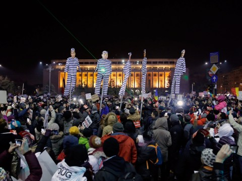 Romania rolls back on corruption law after massive protests