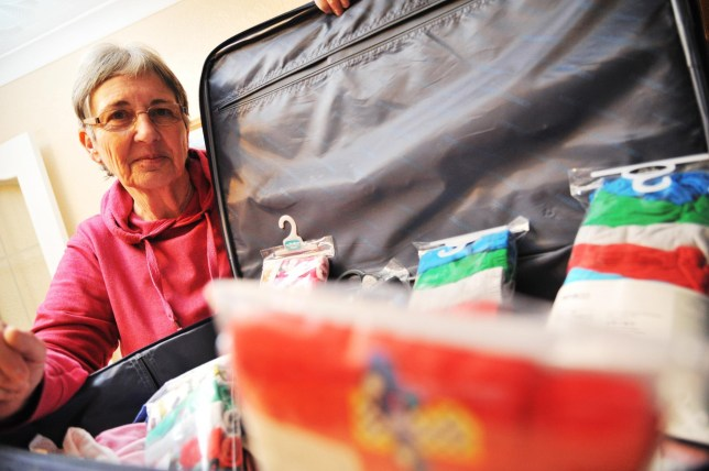 Brenda Johnson, 68 who was told to pay 800GBP to fly clothes to Africa. See SWNS copy SWFLY: AN AID worker planning to fly to Africa to help disabled orphans is angry after being told she canít take a much-needed suitcase full of underwear for the children without paying an £800 excess baggage charge. Brenda Johnson, 68, from Stratton, is due to make the 5,000 mile trip to Africa in May to take care of severely disabled kids in a remote village in Zambia. But on Wednesday she was dealt a bitterr blow when the airline, Emirates, informed her that she couldnít fly with a second bag containing childrenís underwear without incurring huge costs.