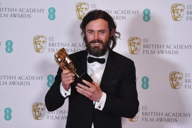 TOPSHOT - US actor Casey Affleck poses with the award for a Leading Actor for his work on the film 'Manchester by the Sea' at the BAFTA British Academy Film Awards at the Royal Albert Hall in London on February 12, 2017. / AFP PHOTO / Ben STANSALLBEN STANSALL/AFP/Getty Images