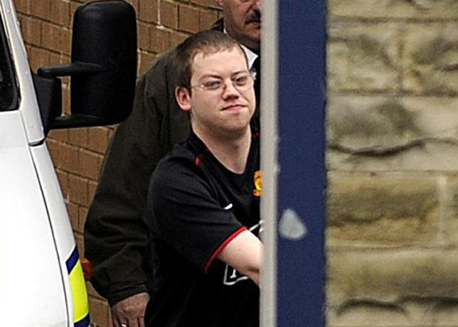 Craig Meehan, stepfather of Shannon Matthews, is led out of Dewsbury Police Station in West Yorkshire, before appearing in court this morning.