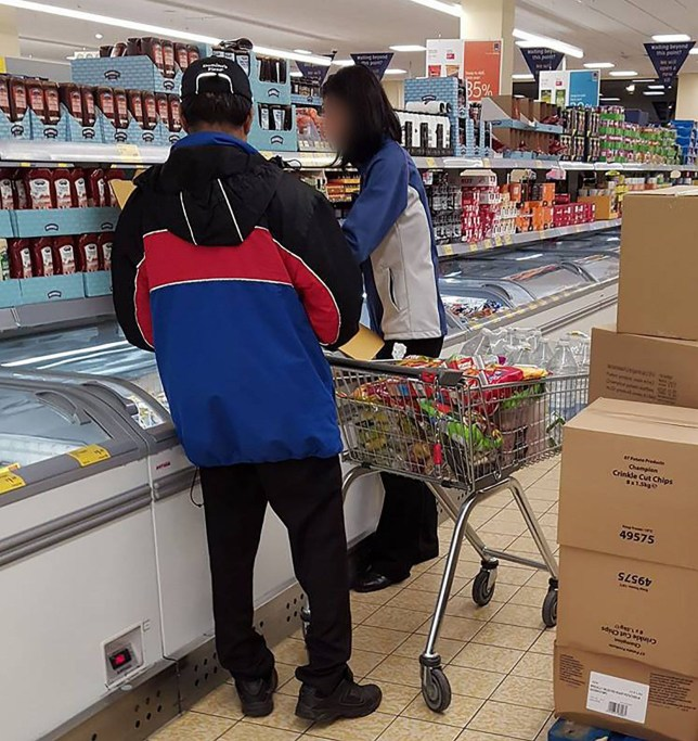 PIC FROM MERCURY PRESS (PICTURED: A DOMINOS EMPLOYEE SHOPPING IN AN ALDI STORE IN DARTFORD, KENT) An enraged shopper complained to Dominoís after spotting a ësheepish-lookingí member of staff piling high a shopping trolley full of hundreds of raw chicken wings and coleslaw from ALDI. Caroline Foskett, 31, was shopping for groceries in the Aldi branch in Dartford, Kent, on Friday February 10, when she spotted the man ëawkwardly wandering up and down the aislesí with a trolley. With what appears to be a Dominoís coat and cap still on, the man was apparently waiting for Aldi staff to restock the freezer after he had emptied it of chicken wings and dippers. Teacher Caroline, from London, claims the man already had six or seven tubs of coleslaw, eight or nine boxes of chicken strips and the same volume in chicken wings. The mum-of-two sent the fast food giant the image in disgust after also spotting Dominoís hit the headlines the week before after staff had been spotted bulk-buying potato wedges in Asda. However Dominoís say they have investigated and believe the member of staff was likely to be just conducting his personal grocery shop, as bottles of water are also clearly visible in the trolley, which they don't sell. SEE MERCURY COPY