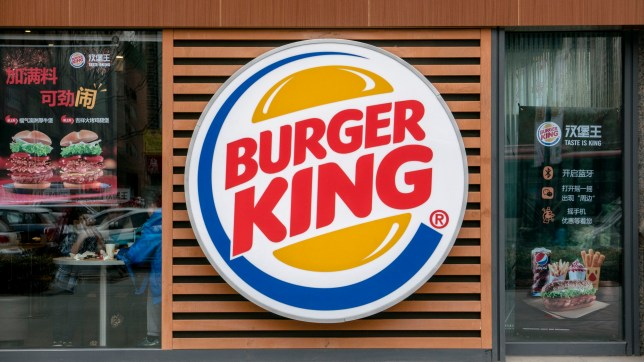 TIANJIN, CHINA - 2016/02/21: Logo of a Burger King restaurant. Burger King is on the first list of retail ends supporting Apple Pay. Burger King, the worlds second largest burger chain restaurant, first entered the China market in 2005, has more than 300 restaurants in the country. (Photo by Zhang Peng/LightRocket via Getty Images)