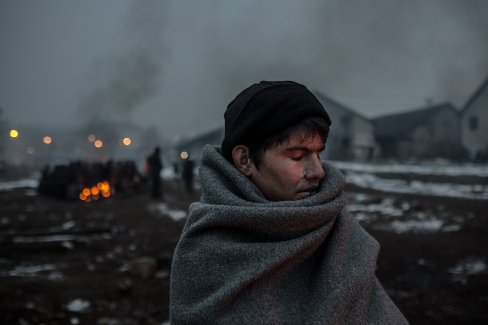 Gritty Pictures Show Refugee Life in Abandoned WarehousesHazrat Ali, a 16-year Afghan refugee, tries to keep warm in freezing conditions in Belgrade. ; In derelict warehouses behind Belgrade's main train station, 1,200 male refugees are sleeping homeless in the freezing cold with temperatures dropping to -20C at night. Among them are around 300 unaccompanied minors. They are living in abandoned buildings, cars and railway carriages, lighting fires to keep warm. The buildings where they are squatting are filled with thick smoke from the fires. UNHCR is deeply concerned about their welfare, with reports of mistreatment by police and authorities and refugees being pushed back when trying to cross the border. Some 7,000 refugees (85 per cent of those stranded in Belgrade) were living in heated government shelters, as of late January 2017.