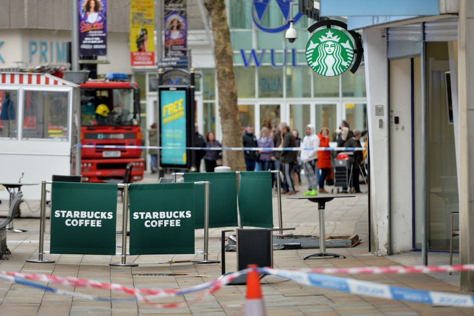 PIC BY CATERS NEWS - (PICTURED: Police and emergency services at the scene of a death on Dudley street , Wolverhampton.) - A woman has been killed by falling debris as Storm Doris hit Wolverhampton city centre. West Midlands Ambulance Service received fifteen 999 emergency calls at 11:43am this morning to Dudley Street outside Starbucks. Two ambulances, a paramedic area support officer and the critical care paramedics from the Midlands Air Ambulance in Staffordshire, who responded on a rapid response vehicle, were sent to the scene. A West Midlands Ambulance Service spokesman said:On arrival, crews found a woman who had suffered very serious head injuries. SEE CATERS COPY.