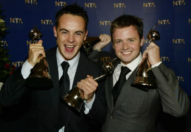 "LONDON - OCTOBER 15: British television presenters Ant McPartlin and Declan Donnely smile after winning the ""Special Recognition Award"" for the program ""SM:TV Live"" at the National TV Awards party at the Royal Albert Hall on October 15, 2002 in London. (Photo by Dave Hogan/Getty Images)"