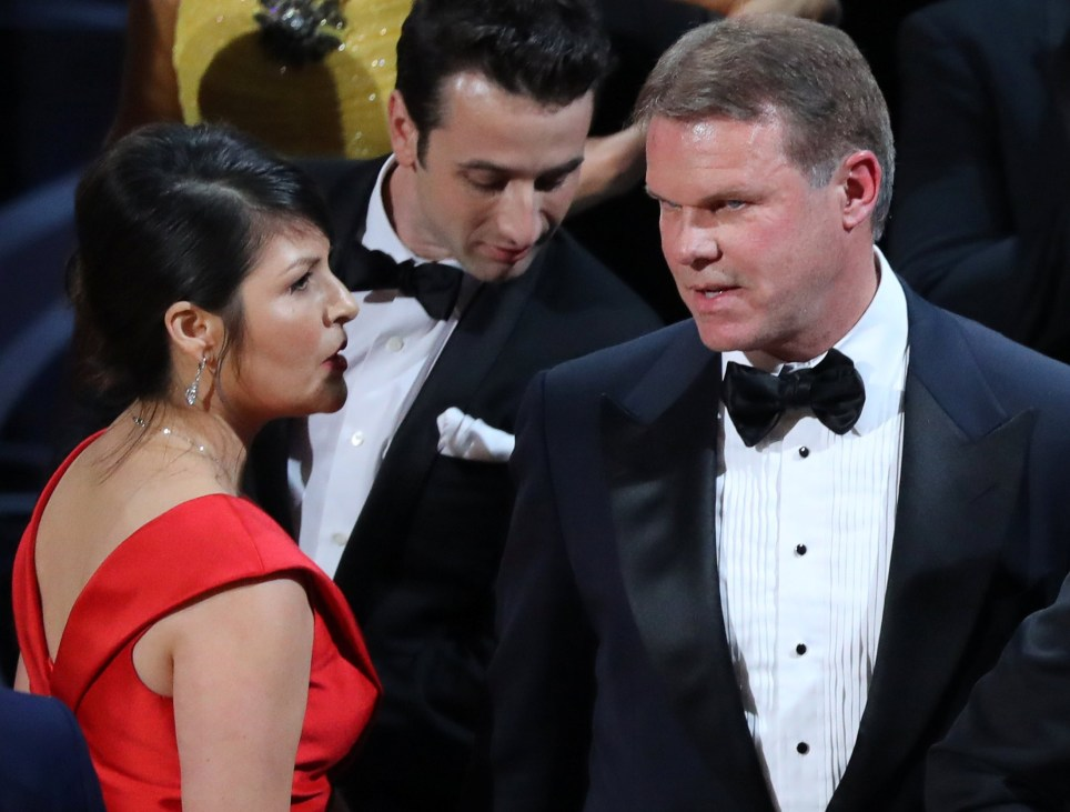 """89th Academy Awards - Oscars Awards Show - Hollywood, California, U.S. - 26/02/17 - Brian Cullinan (R) and Martha Ruiz (L) of PricewaterhouseCoopers confer on stage after the Best Picture was mistakenly awarded to """"La La Land"""" instead of """"Moonlight"""". Cullinan gave presenters Warren Beatty and Faye Dunaway the wrong envelope for the Best Picture Award, accounting firm PricewaterhouseCoopers said in a statement. REUTERS/Lucy Nicholson TPX IMAGES OF THE DAY"""