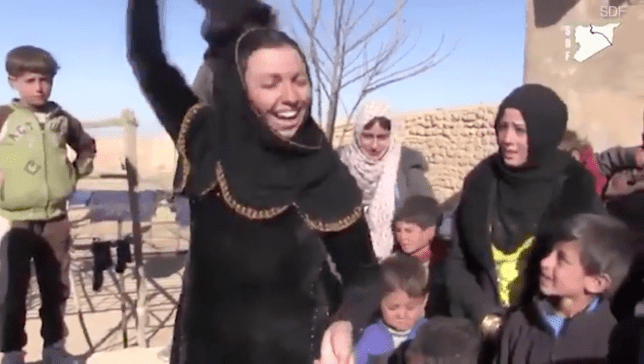 Overjoyed woman rips a face veil before burning it (Pictures: SDF)