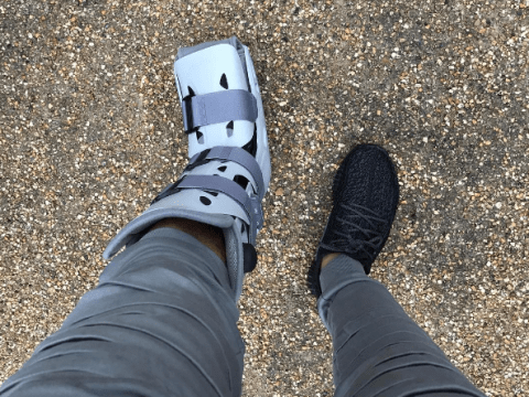 Arsenal's Mohamed Elneny wearing protective boot after FA Cup injury