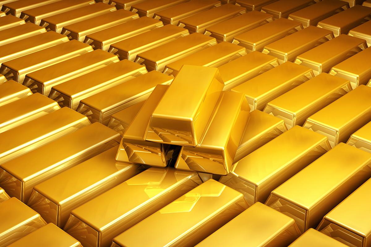 (Picture: Shutterstock) Many shiny gold bars - Goldbarren