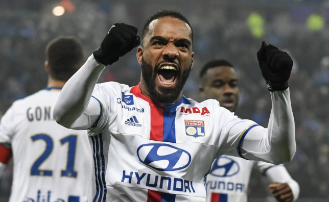 Lyon's French forward Alexandre Lacazette celebrates after scoring a goal during the French L1 football match Olympique Lyonnais (OL) vs Marseille (OM) on January 22, 2017, at the Parc Olympique Lyonnais stadium in Decines-Charpieu, central-eastern France. / AFP / JEFF PACHOUD (Photo credit should read JEFF PACHOUD/AFP/Getty Images)