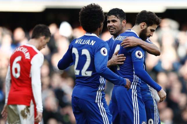 Chelsea's Spanish midfielder Cesc Fabregas (R) celebrates scoring their third goal with Chelsea's Brazilian-born Spanish striker Diego Costa (2R) during the English Premier League football match between Chelsea and Arsenal at Stamford Bridge in London on February 4, 2017. / AFP / Adrian DENNIS / RESTRICTED TO EDITORIAL USE. No use with unauthorized audio, video, data, fixture lists, club/league logos or 'live' services. Online in-match use limited to 75 images, no video emulation. No use in betting, games or single club/league/player publications. / (Photo credit should read ADRIAN DENNIS/AFP/Getty Images)