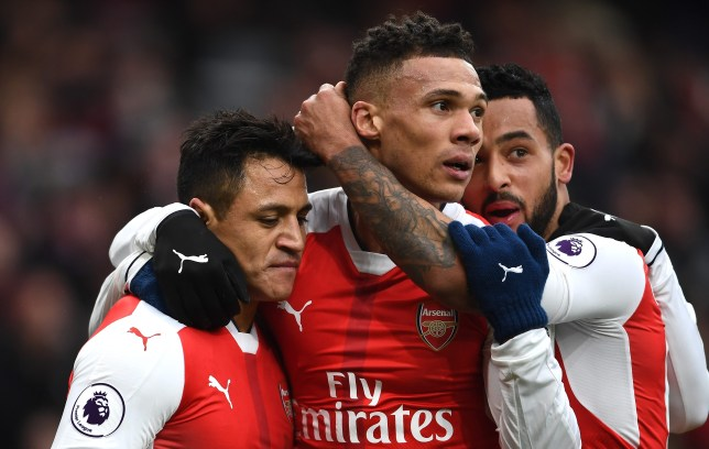 LONDON, ENGLAND - FEBRUARY 11:  Alexis Sanchez (L) of Arsenal celebrates scoring the opening goal with his team mates Kieran Gibbs (C) and Theo Walcott (R) during the Premier League match between Arsenal and Hull City at Emirates Stadium on February 11, 2017 in London, England.  (Photo by Laurence Griffiths/Getty Images)