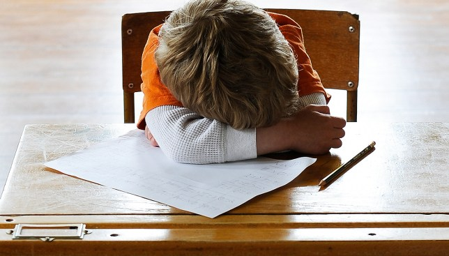 Schoolboy struggling in educational exam Getty Images