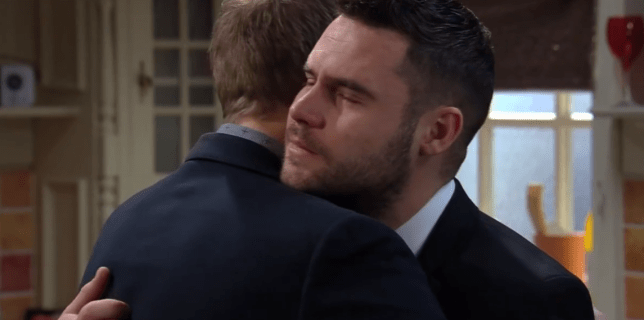 Robert and Aaron embrace in Emmerdale